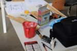 a work table with art supplies for the art making process by j. haley